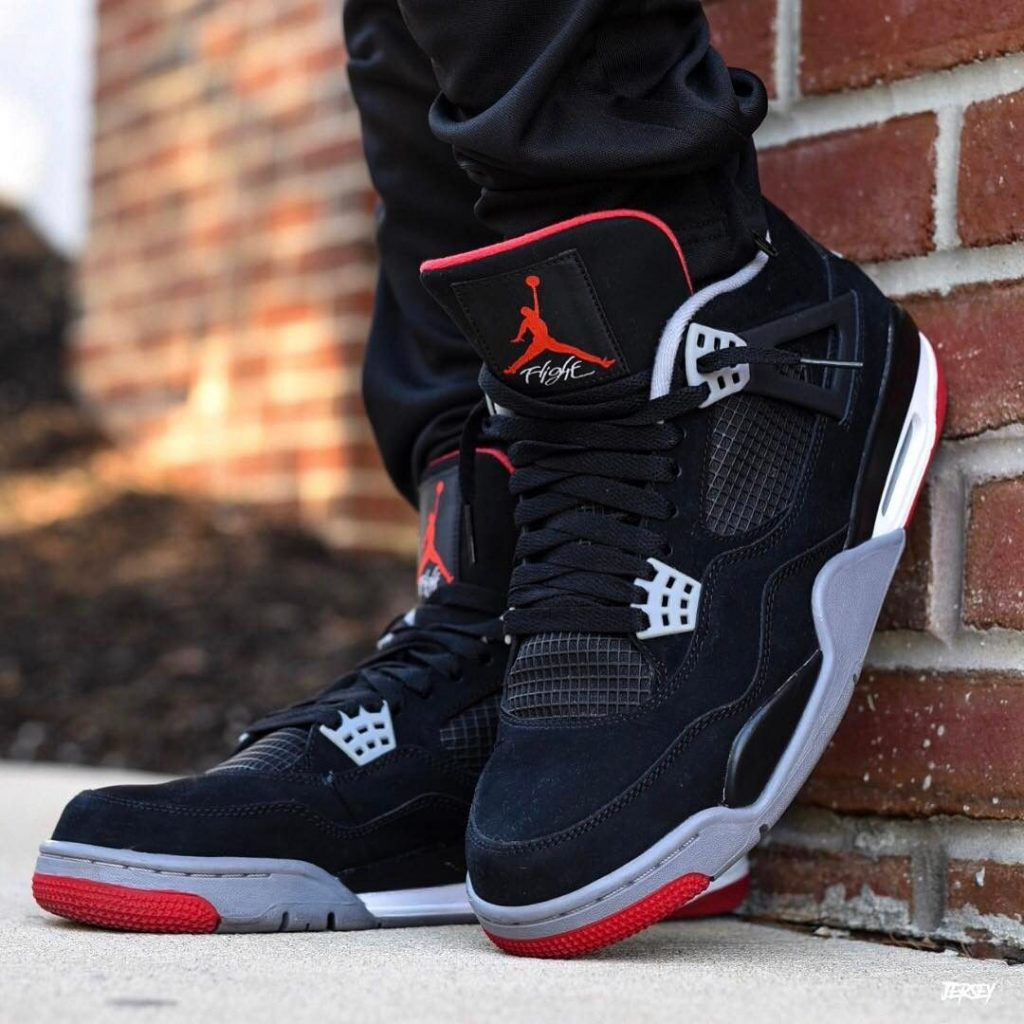Someone wearing the Air Jordan 4 Bred